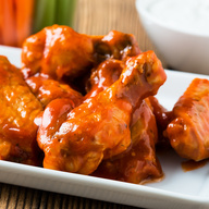Fresh Chicken Drumsticks. Deep Fried in Our Famous Breading & Smothered in your favorite Sauce